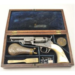 Colt 1849 Pocket Model Percussion revolver in  .31 caliber showing fully and finely deluxe  engravin