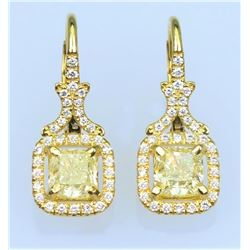 Elegant Fancy Yellow and White Diamond  Earrings featuring two matching Radiant Cut  Diamonds weighi