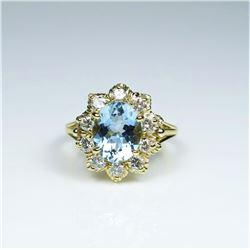 Stunning Santa Maria Blue Aquamarine and  Diamond Ring featuring an oval cut Aquamarine  weighing ap