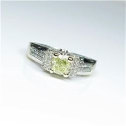 Brilliant Fancy Yellow and White Diamond Ring  featuring a cushion cut light Fancy Yellow  Diamond w