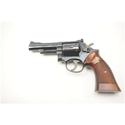 "Smith & Wesson 19-3 Double Action Revolver  with a 4"" pinned barrel, target grips and  hammer, 7K266"