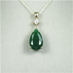Elegant 8.50 carat Emerald and Diamond  pendant featuring a richly colored pear  shaped Emerald acce
