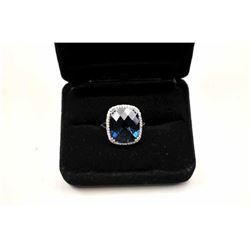 Beautiful London Blue Topaz ring with  diamonds.  The ring is nicely done in 14K  white gold with an