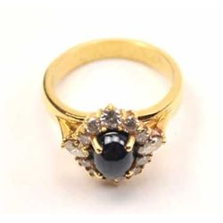 Outstanding blue sapphire and diamond ladies  ring set in 18K yellow gold.  The ring  features a gre