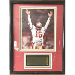 Color photo of Joe Montana personally signed  and dated (1994) with a certificate by  Jonathan Grey
