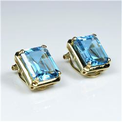 Stunning Swiss Blue Topaz and Diamond  Earrings featuring 2 emerald cut Blue Topaz  weighing approx.