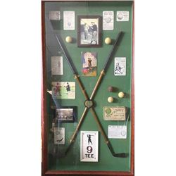 Golfing display with vintage wood clubs and  old balls displayed in beautiful custom made  case. Mea