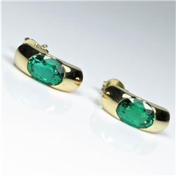 Sophisticated Chatham created Emerald  Earrings featuring 2 oval cut matching  Emeralds weighing app