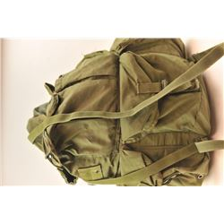 Lot of 10 canvas O.D. green and digital  camouflage rucksacks, back packs and gear  hauling bags.  P