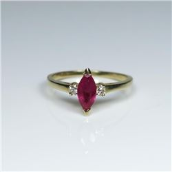 Pretty Burmese colored Ruby and Diamond Ring  featuring a marquise cut Ruby weighing  approx.  0.80