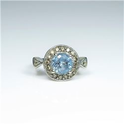 Stylish Aquamarine and Diamond Ring featuring  a round Aquamarine weighing approx. 4.00  carats enci