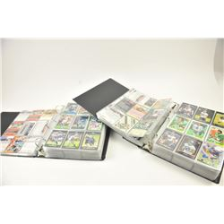 Large lot of graded and ungraded football  trading cards including three full binders  with protecti