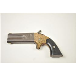 American Standard Wheeler's Paten O/U  Derringer in .22/.32 caliber with original  New York Scroll e