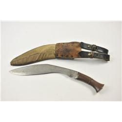 A genuine British Army of India WWII military  Kukri or Ghurka knife in original scabbard.  The curv