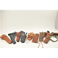 Bonanza box lot of commercial holsters from a  police officer/collector dating back to the  1950's i