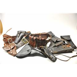 Lot of vintage holsters from an old time  collector, including Luger, P-38, three U.S.,  .45 Auto, s