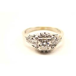 One beautifully designed vintage ring in 14k  white gold set with a ¼ ct center and 18 side  diamond