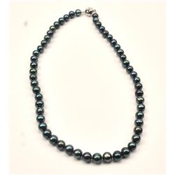 One beautiful strand of black pearls 20  inches long and are 9 mm in diameter   Est:$250-500