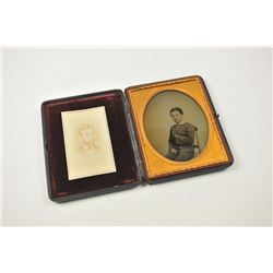 Photographic image lot consisting of an  ambrotype depicting a young squire, cased in  Moroccan leat