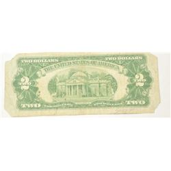 """$2 dollar bill dated 1928 Series G,  circulated with corners clipped signed in  pen, """"Babe Ruth"""".  T"""