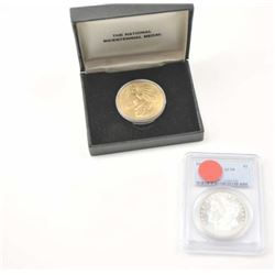 1921-S Morgan silver dollar, PCGS graded  AU-58 with a gold plated U.S. Bi-Centennial  medal in the