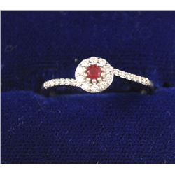 One petite ruby diamond halo ring made in 18  k white gold Est:$150-300