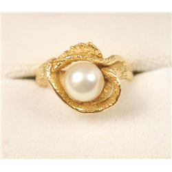 One free form carved ring in 14 k yellow gold  set with a beautiful round pearl  Est:$150-300