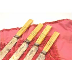 Lot of four bone handled fish knives with  silver blades.  The grips have been  scrimshawed with the