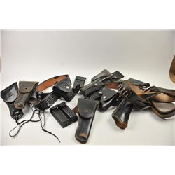 Leather lot of 2 basket weave gun belts, 6  leather flap duty holsters and 2 leather  magazine pouch
