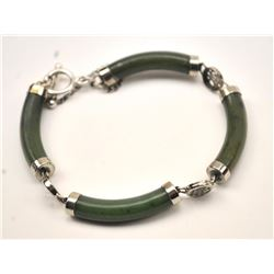 One beautifully fabricated green jade  bracelet with toggle clasp and safety chain  Est:$75-150