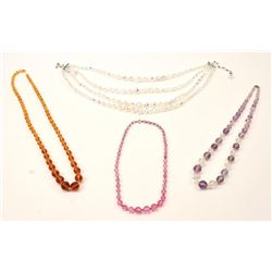 A collection of crystal, garnet, rose quartz,  and amethyst  faceted bead necklace    Est:$50-100