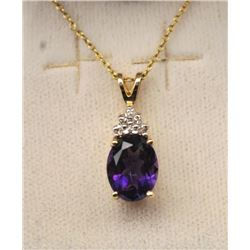 One fine oval Mozambique amethyst set in 14k  yellow gold pendant  with diamonds  Est:$150-300