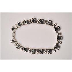 One beautifully hand fabricated necklace made  in sterling silver weighing 74.6grams   Est:$175-350