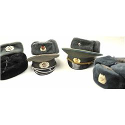 Lot of post WWII Eastern block caps and  winter hats. 7 total all with emblems. Good  to very good p