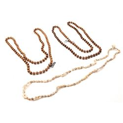 A collection of 2 genuine Lucite bead and a  miniature conch shell necklace longer than 30  inches