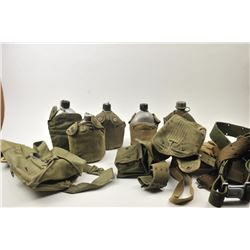 Bonanza lot of military items including  canteens, mess kits and other assorted  military gear.  Est