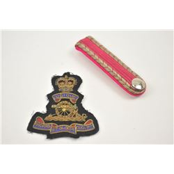 Lot of two insignias from an estate in a  paper envelope.  The lot includes British art  patch with