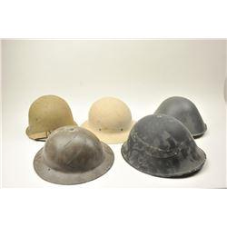 "Lot of 7 helmets as described: 1. U.S. Civil Defense helmet. Good with liner  and straps. Marked ""L."