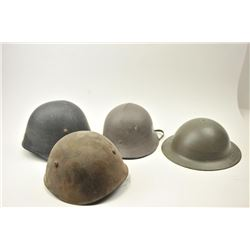 Lot of 4 foreign helmets all with liners.  Varied condition from fair to very good.  Est.: $100-$200