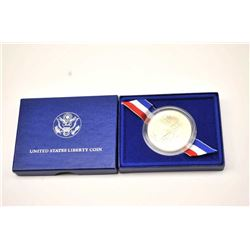 One commemorative statue of liberty  one  ounce silver dollar proof set in box with  certificate Est