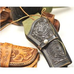 Lot of three tooled leather cartridge belts  with single action holsters.  The holsters  are in fair