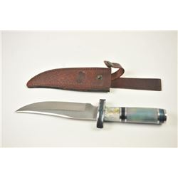 Large Chipaway Cutlery clip point Bowie knife  with a tooled leather belt scabbard.  The  knife is 1