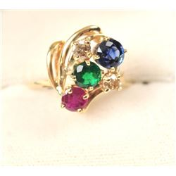 One beautifully designed multi gem ring  containing ruby, sapphire,emerald and 2  yellow diamonds se