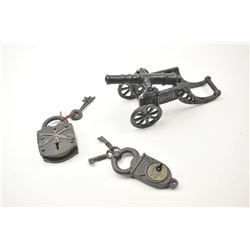 Lot of two vintage padlocks and a cast iron  cannon with carriage.  One padlock has  crossed cavalry