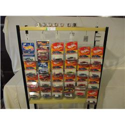 """31 N.I.P Assorted Chevrolet Hot Wheels and John Lightning Cars with Metal Display Shelf 10"""" by 70""""T"""