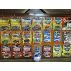 """Framed Display Peg Board 26"""" by 44"""" with 21 N.I.P Miniature Chevrolet Trucks and Cars"""