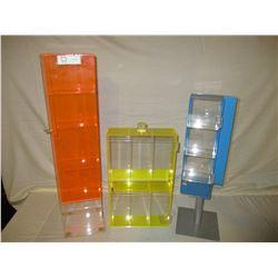 3 Assorted Plastic Showcases