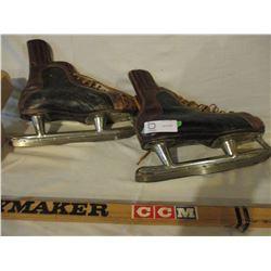Old CCM Hockey Sticks, Skates and 7 Pucks