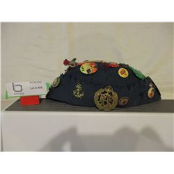 Old Beanie Cap with Vintage Pins and Red Cross Pins