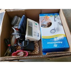 Box of blood pressure monitor, thermassager, shower head and hot water bottle